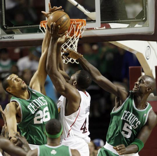 Celtics Patrick O'Bryant (left) and Kevin Garnett double-team Philadelphia's Elton Brand.