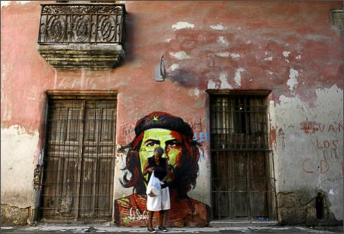 See more photography at Boston.com/photos A woman walks past a graffiti depicting Argentine-born revolutionary hero Ernesto 'Che' Guevara in Havana, Wednesday, Oct. 8, 2008. Cuba marks the 41st anniversary of 'Che' Guevara's death on Oct. 8, although he was killed on Oct. 9, 1967 in the town of La Higuera, Bolivia.