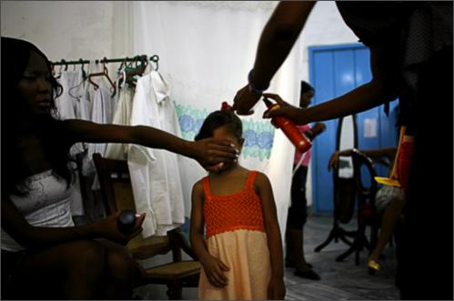 See more photography at Boston.com/photos A young model gets her hair done prior to the 'Endless Love' youth fashion show by Cuban designers in Havana, Tuesday, Sept. 23, 2008.
