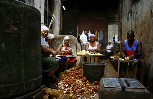 See more photography at Boston.com/photos Workers peel sweet potatoes for a school in Havana, Monday, Sept. 29, 2008. Cuba has frozen prices at farmers' markets and is promising to punish vendors who charge more for hard-to-find food as reserves dwindle following two hurricanes.