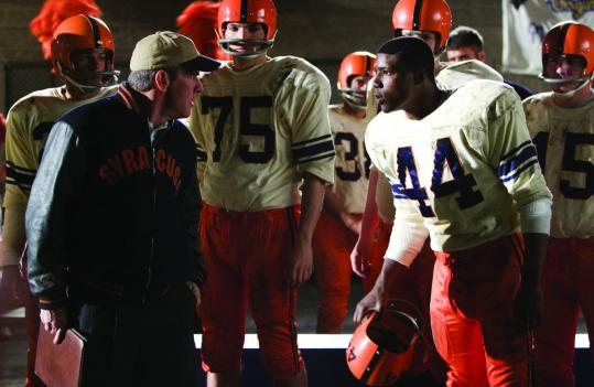 Rob Brown (right, with Dennis Quaid) stars as Ernie Davis, the first African-American to win the Heisman Trophy.