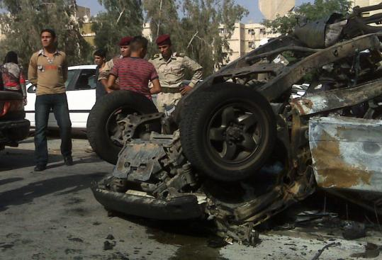 This Iraqi Defense Ministry vehicle was destroyed earlier this week by a magnetic bomb that had been affixed beneath it. Iraqi insurgents are increasingly using ''sticky IEDs'' to assassinate government officials.
