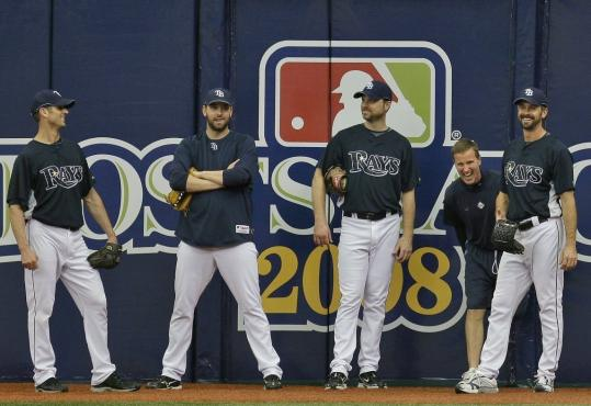 Rays pitchers (from left) Grant Balfour, Dan Wheeler, Chad Bradford, and Trever Miller share a light moment with strength and conditioning coach Kevin Barr at yesterday's workout.