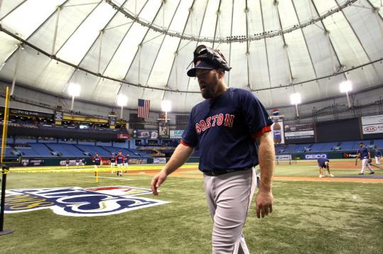 Kevin Youkilis, sporting some leather after yesterday's workout, said of The Trop, ''It's a different atmosphere.''