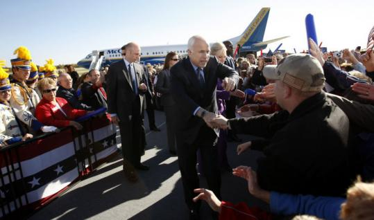 John McCain greeted a supporter yesterday in Mosinee, Wisc.