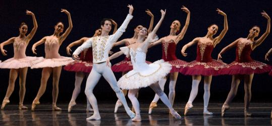 Nelson Madrigal and Lorna Feijoo (in front) with Boston Ballet corps members in ''Paquita.''