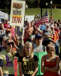 WENDY MAEDA/GLOBE STAFF Hundreds of protesters gathered on Boston Common yesterday, the sixth anniversary of the congressional vote to authorize the invasion of Iraq.