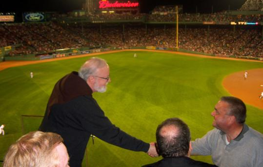 Cardinal Seán P. O'Malley, shown chatting with people at Fenway last month, has seen Boston win two championships.