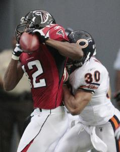 The Georgia Dome crowd was deflated after Chicago pulled ahead with 11 seconds left. That all changed when Michael Jenkins (left) caught a 26-yard pass and Jason Elam kicked a 48-yard FG.