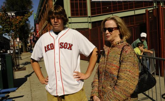 Nicholas Steblenko (top left) of Potsdam, N.Y., and his aunt, Patricia Segerson of Shrewsbury, took a tour of Fenway Park yesterday. Above right: Billy Welch of Dracut, with his dog, Zoe, along with Paul Blaney think the Red Sox have a good chance to win the ALCS. ''Probably going to go seven games,'' Welch said.