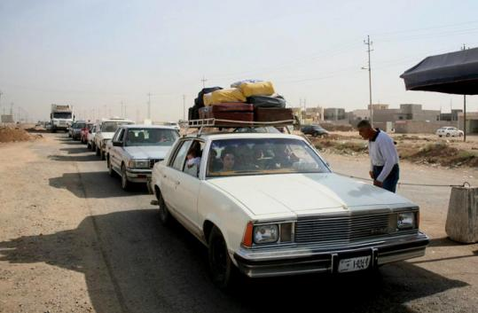 A Christian family, with a loaded-up car, stopped at a checkpoint east of Mosul yesterday in an attempt to flee.