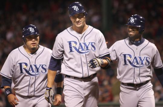 The Rays' third homer came from Rocco Baldelli (center), who drove in Dioner Navarro (left) and Fernando Perez.