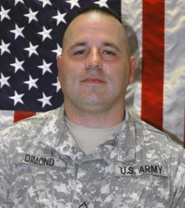 National Guard Corporal Scott Dimond was deployed to Afghanistan in January. He had served on the police force in the city of Franklin, N.H., from 1988 to 2006, as an officer and a sergeant.