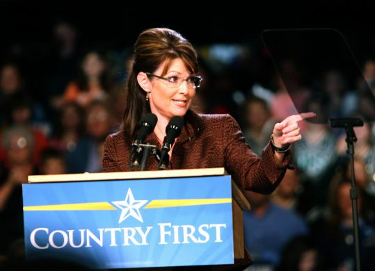 Sarah Palin addressed supporters at a rally yesterday at Dover High School in Dover, N.H. Below, she spoke at an outdoor rally in Laconia, N.H., before a crowd of more than 2,000.