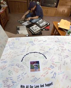 While inspecting scrapbooks from his baseball career, Greg Montalbano is heartened by an addition to his collection of memorabilia - a giant get-well card from friends and family.