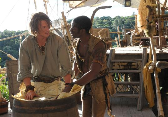 Philip Winchester (left) as Robinson Crusoe and Tongayi Chirisa as Friday in NBC's two-hour drama.