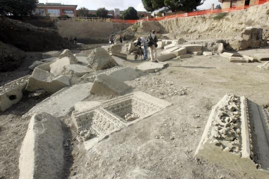 The ruins of a tomb for a general who led ancient Rome's legions was unveiled yesterday. A city of the dead was also among new archeological finds announced in the Italian capital.
