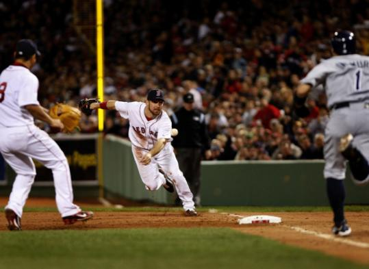 Mark Kotsay shovels the ball to a charging Daisuke Matsuzaka, who beat Akinori Iwamura to the bag in the third inning.