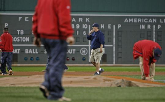 Dave Mellor was in his customary role supervising the grounds crew as it prepared the Fenway field for Game 5 last night.