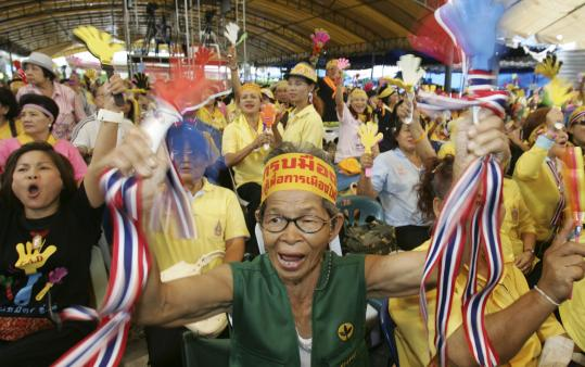 Anti-government protesters celebrated inside the government house in Bangkok yesterday when a Thai court found former prime minister Thaksin Shinawatra (left) guilty of corruption and sentenced him to two years in prison, further deepening the country's paralyzing political crisis