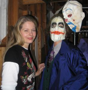 Jeannine Conway at her Weymouth garage, with a mannequin dressed as the Joker in the movie ''The Dark Knight.''