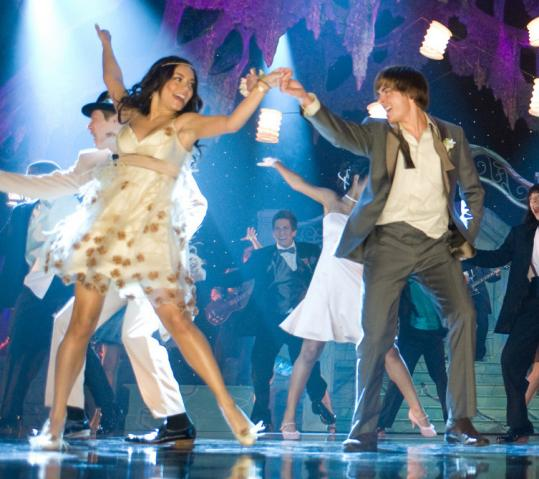 Back at East High, Vanessa Hudgens and Zac Efron perform in a prom-theme production number.