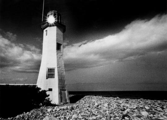 The Scituate Lighthouse, circa 1986. In 1814, a pair of clever sisters kept the British at bay with a mighty racket.