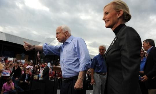 ROBYN BECK/AFP/GETTY IMAGESJohn and Cindy McCain rallied with supporters yesterday at a building supply company in Ormond Beach, Fla.