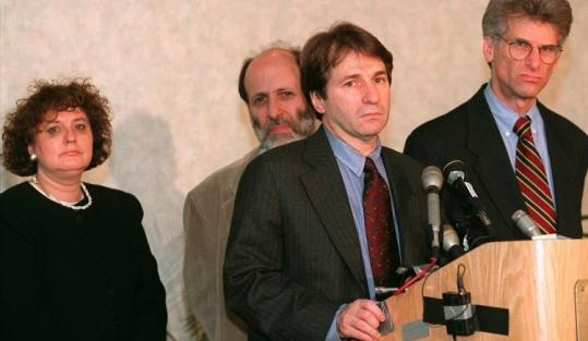 (From left) Elaine Sharp, Harvey Silverglate, Barry Scheck, and Andrew Good at a 1997 press conference. Sharp had accused the men of damaging her reputation by publicly announcing that they fired her.