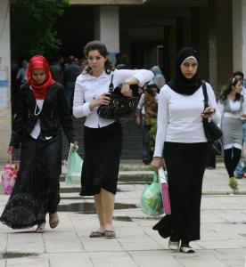 Iraqi students at Baghdad University this week. The decision by some women to shun the Islamic head cover is one sign of growing confidence in the past year's security gains.