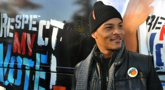 Clifford Harris, known as T.I., smiles after voting yesterday.