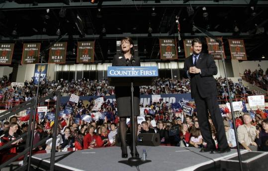 Sarah Palin, with her husband, Todd, spoke yesterday at Bowling Green University in Ohio. Joe Wurzelbacher, also known as ''Joe the plumber'' of Holland, Ohio, campaigned with Palin for the first time at the event.