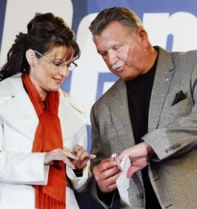 Former Chicago Bears coach Mike Ditka showed his Super Bowl ring to vice presidential candidate Sarah Palin in Latrobe, Pa., yesterday.