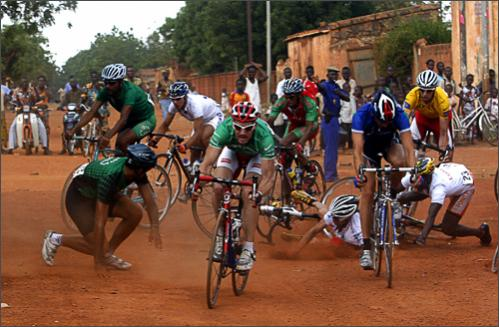 Riders fall on a dusty road during the 6th stage of the 22nd Tour du Faso cycling race between Laye and Ouahigouya, Burkina Faso, Wednesday, Oct. 29, 2008.