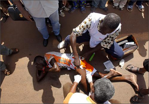 A medic tends to Ivory Coast's Ahmed Ouedraogo after the fifth stage of the 22nd Tour du Faso cycling race between Bobo Dioulasso and Hounde, Burkina Faso, Tuesday, Oct. 28, 2008.