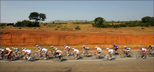The pack rides during the second stage of the 22nd Tour du Faso cycling race between Boromo and Diebougou, Burkina Faso, Saturday, Oct. 25, 2008.