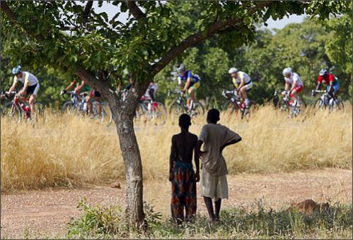 Young boys watch riders during the eighth stage of the 22nd Tour du Faso cycling race between Koulbila and Tenkodogo, Burkina Faso, Friday, Oct. 31, 2008. See more photography at Boston.com/photos