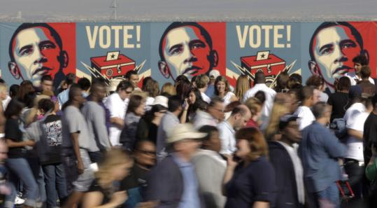 Supporters passed a banner depicting Senator Barack Obama after a rally yesterday in Henderson, Nev.