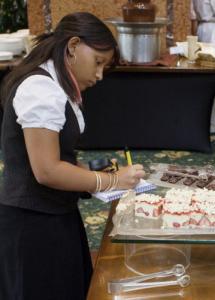 Thirteen-year-old Eva Hernandez of Roxbury takes notes at the Chocolate Bar.