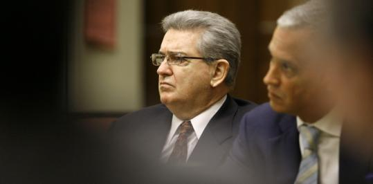 Former FBI agent John Connolly (left), listened to a federal judge yesterday during Connolly's murder trial in Miami.