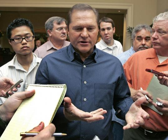 Agent Scott Boras answers questions upon arriving at the general managers meetings. Client Jason Varitek was one hot topic.