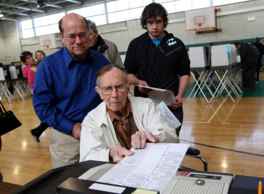 Milton Beecher, 99, his son, Edward, 59, and Edward's son, Robert, 18, voted yesterday at Hopkinton Middle School. All three cast their ballots for Barack Obama.