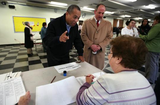 Governor Deval Patrick and Senator Brian A. Joyce, a neighbor, arrived to vote at St. Mary of the Hills School in Milton.