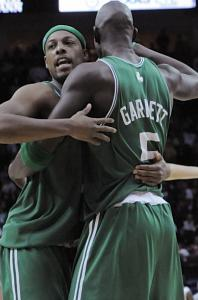 Paul Pierce and Kevin Garnett bump after getting over the hump late in the Celtics' victory.