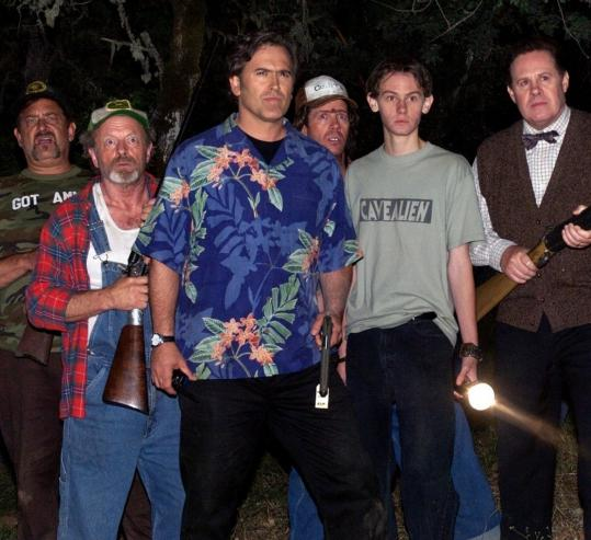 Bruce Campbell (in Hawaiian shirt), playing a pompous Z-movie actor named Bruce Campbell, leads townspeople against a resurrected Chinese god in ''My Name Is Bruce.''