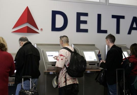 Delta will charge $15 for the first checked bag and $25 for the second starting Dec. 5.