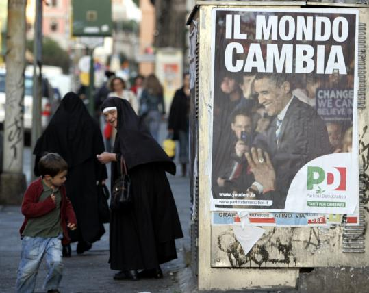 Italians passed a poster put up in Rome by the country's Democratic Party showing a picture of President-elect Barack Obama and reading, ''The World Changes.'' Below, a man at a Paris newsstand arranged international papers headlining the win.