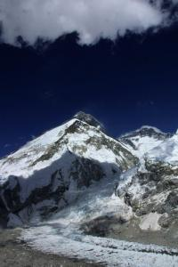 The Khumbu Icefall with Mount Everest outlined behind it and Lhotse peak on the right.