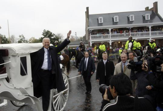 RETURNING IN TRIUMPH - Vice President-elect Joe Biden returned home yesterday for Delaware's traditional Return Day celebration in which winners and losers in political campaigns join each other to ''bury the hatchet.''