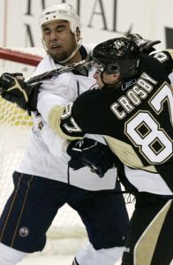 Sidney Crosby gets up close and personal with Edmonton's Fernando Pisani in the first period of the Penguins' 5-4 victory.